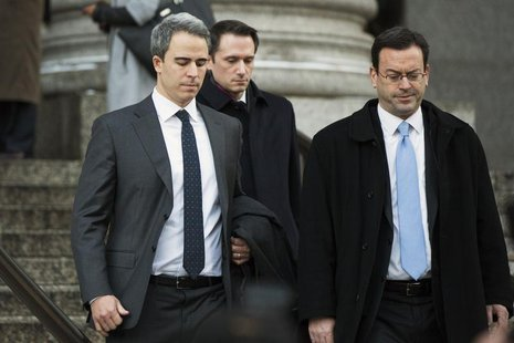 Michael Steinberg (L), a top portfolio manager at Steven A. Cohen's SAC Capital Advisors hedge fund, departs Federal Court in Manhattan afte