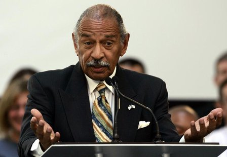 U.S. Representative John Conyers addresses the audience during a news conference at the Ford Motor Research & Innovation Center in Dearborn,