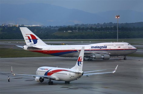 Malaysia Airlines aircrafts taxi on the runway at Kuala Lumpur International Airport in Sepang outside Kuala Lumpur May 13, 2014. REUTERS/Sa