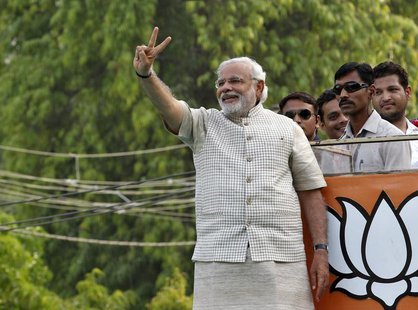 Hindu nationalist Narendra Modi, the prime ministerial candidate for India's main opposition Bharatiya Janata Party (BJP), gestures during a