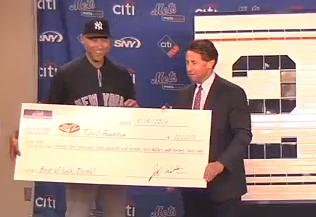 Yankee Captain Derek Jeter receives check for $22,222.22 for the foundation and the big tile artwork.