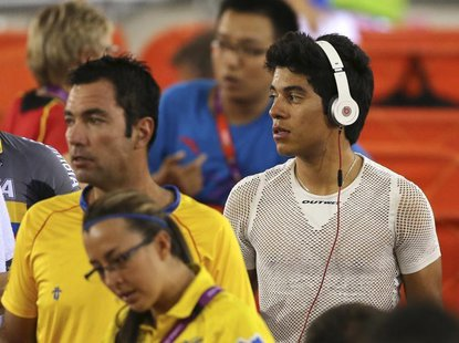 Colombia's track cyclist Edwin Alcibiades Avila Vanegas uses a pair of Beats by Dr. Dre headphones at the Velodrome during the London 2012 O