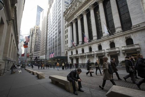 People walk by the New York Stock Exchange in New York's financial district March 11, 2014. REUTERS/Brendan McDermid