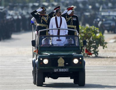 Sri Lanka's President Mahinda Rajapaksa (in white) takes part in a War Victory parade in Matara May 18, 2014. REUTERS/Dinuka Liyanawatte