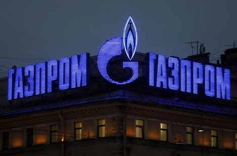 The company logo of Russian natural gas producer Gazprom is seen on an advertisement installed on the roof of a building in St. Petersburg,
