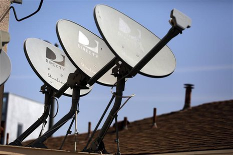 DirecTV satellite dishes are seen on an apartment roof in Los Angeles, California May 18, 2014. tes. REUTERS/Jonathan Alcorn