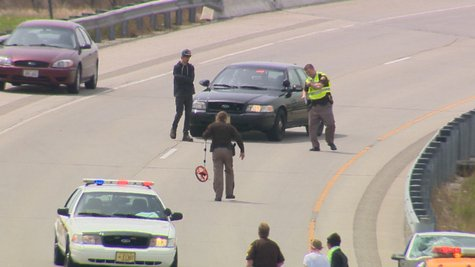 Authorities on scene after a survey crew worker was hit on the Hwy. 172 eastbound ramp on Monday, May 19, 2014. (Photo from: FOX 11.)
