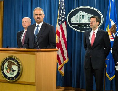 U.S. Attorney General Eric Holder (2nd L) announces the indictments of five Chinese nationals on cyber espionage charges for allegedly steal
