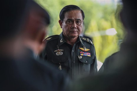 Thai Army chief General Prayuth Chan-ocha arrives before a meeting with high ranking officials at the Army Club, after the army declared mar