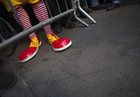 A protester Ben dressed up as Ronald McDonald, only known as Ben, takes part in a protest outside a McDonalds restaurant to demand higher wa