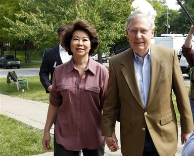 Senate Republican Leader Sen. Mitch McConnell (R-KY) and his wife Elaine Chao arrive at Bellarmine University to cast their ballots during K