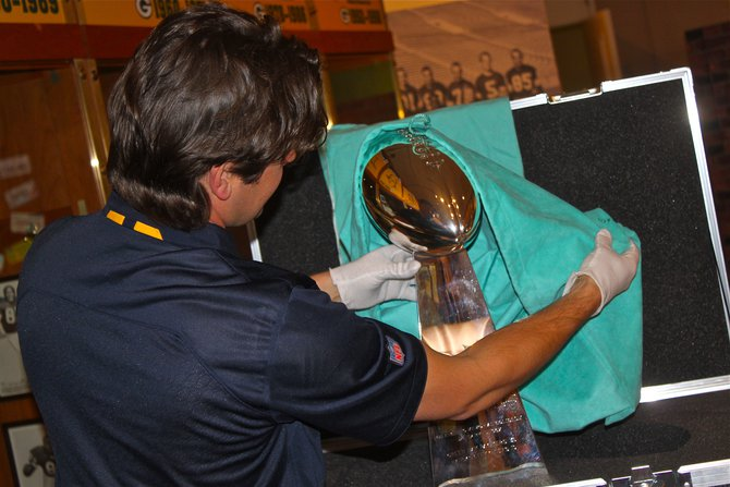 Placing the Super Bowl I Trophy at the Packers Hall of Fame Touchdown Exhibit at The Neville Public Museum in Green Bay