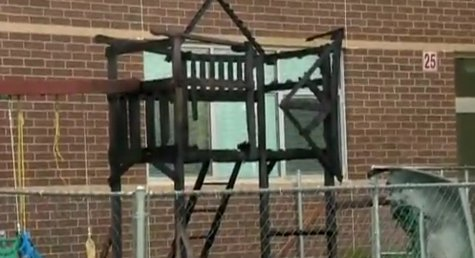 Fire damages the playground at New London High School on May 20, 2014. (Photo from: FOX 11/YouTube).