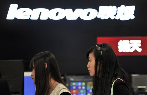 People walk past a Lenovo shop in Hefei, Anhui province, in this October 18, 2013 file photo. REUTERS/Stringer/Files