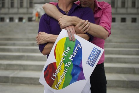 Mike Woods, 28, and Brandon Parsons, 30, embrace on the Pennsylvania State Capital steps following a rally with gay rights supporters after