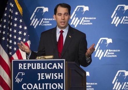 Wisconsin Governor Scott Walker speaks during the Republican Jewish Coalition Spring Leadership Meeting at the Venetian Resort in Las Vegas,