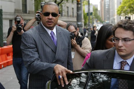 Former New York State Assemblyman Eric Stevenson (L) gets into his car as he leaves the Manhattan Federal Court in New York May 21, 2014. RE