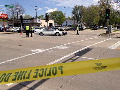 Appleton police officers on the scene of a car and motorcycle crash at the intersection of E. Glendale Ave. and N. Meade St. on Wednesday, May 21, 2014. (Photo from: FOX 11.)