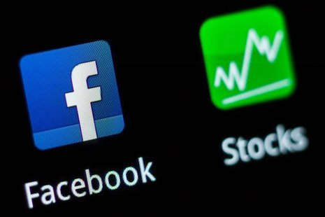 A Facebook application logo is pictured on a mobile phone in this photo illustration taken in Lavigny May 16, 2012. REUTERS/Valentin Flaurau