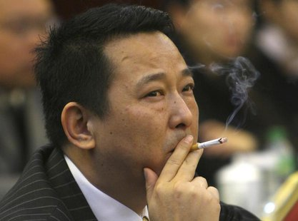 Liu Han, former chairman of Hanlong Mining, smokes a cigarette during a conference in Mianyang, Sichuan province, in this picture taken Marc