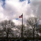 A view of the latest ACUITY Insurance flag pole and flag on top.