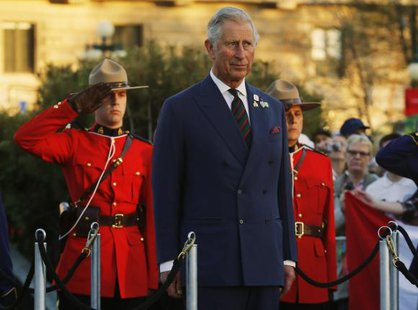 Britain's Prince Charles looks on during his farewell ceremony in Winnipeg, Manitoba, May 21, 2014. CREDIT: REUTERS/MARK BLINCH