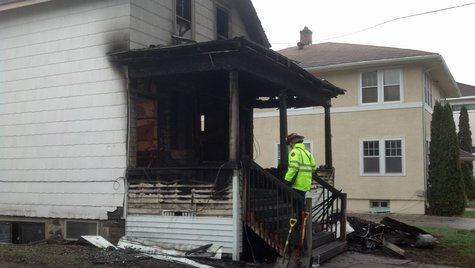 Investigators at scene of fire Monday, May 19, 2014 in North Fargo