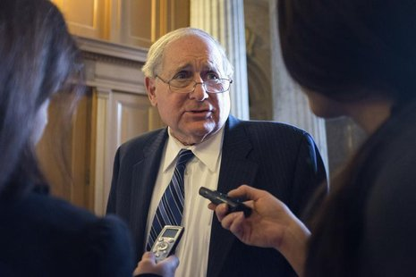 Senator Carl Levin (D-MI) speaks to reporters as he arrives for the Democratic weekly policy luncheon on Capitol Hill in Washington January