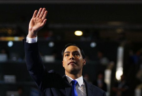 Keynote speaker and San Antonio, Texas Mayor Julian Castro waves while addressing the first session of the Democratic National Convention in