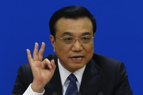 China's Premier Li Keqiang gestures as he speaks during a news conference, after the closing ceremony of the Chinese National People's Congr