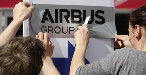 Volunteers prepare an Airbus sign for the upcoming ILA Berlin Air Show in Selchow near Schoenefeld south of Berlin May 19, 2014. The ILA run