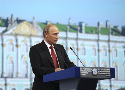 Russia's President Vladimir Putin speaks during a session of the St. Petersburg International Economic Forum 2014 (SPIEF 2014) in St. Peters