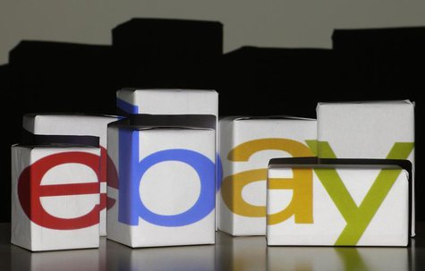 An eBay logo is projected onto white boxes in this illustration picture taken in Warsaw, January 21, 2014. REUTERS white RS/Kacper Pempel