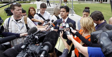 Attorney Charles Frisco (C) speaks during a news conference after a jailhouse video court hearing for Isidro Garcia in Santa Ana, California