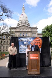 State Senator Bruce Caswell with Robin Creel, widow of killed Consumers Energy employee Jeff Creel, during a Slow Down and Go Ahead presentation at the Michigan State Capitol May 22, 2014