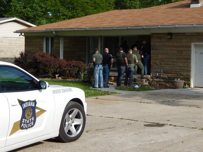 Police enter Armstrong home. photo provided by ISP