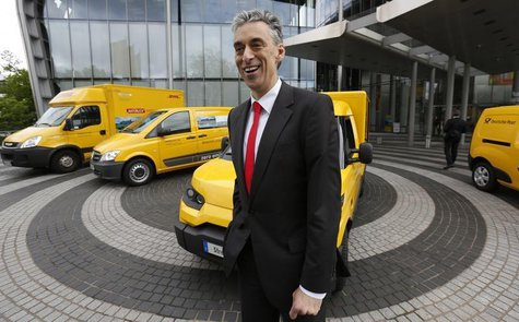 Frank Appel, CEO of German postal and logistics group Deutsche Post DHL poses in front of a StreetScooter E-car and other E-cars in Bonn May
