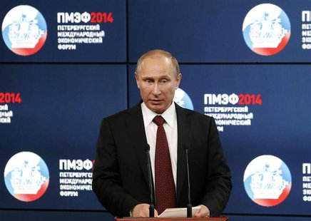 "Russia's President Vladimir Putin delivers a speech during the ""Oil and gas companies as an engine driving change in the world economy"" sess"