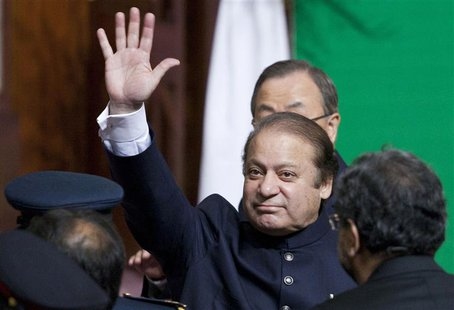 Pakistan's Prime Minister Nawaz Sharif waves to the crowd as he leaves after attending a flag raising ceremony to mark the country's 67th In