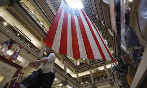 A shopper walks past a giant U.S. flag on display, ahead of the Memorial Day holiday, in a department store in Chicago, Illinois, May 23, 20