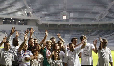 Brazil's President Dilma Rousseff (C) poses with workers as she visits the Arena da Baixada stadium in Curitiba May 9, 2014. REUTERS/Rodolfo