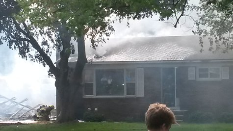A fire strikes a Dartmouth Avenue house in the Holland Heights neighborhood on May 26, 2014.