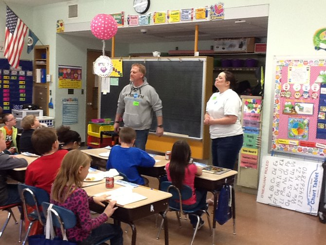 Craig and Rachel talk to the kids about reading and radio.