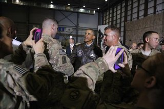 Soldiers take photos as U.S. President Barack Obama (C) shakes hands with troops after delivering remarks at Bagram Air Base in Kabul, May 25, 2014. CREDIT: REUTERS/JONATHAN ERNST