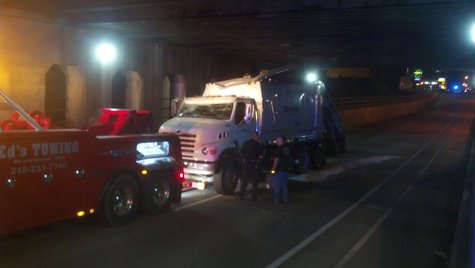 Truck hits underpass