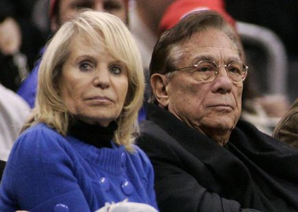 Los Angeles Clippers owner Donald Sterling (C), his wife Shelly (L) attend the NBA basketball game between the Toronto Raptors and the Los Angeles Clippers at the Staples Center in Los Angeles, in this December 22, 2008 file photo. CREDIT: REUTERS/DANNY MOLOSHOK/FILES