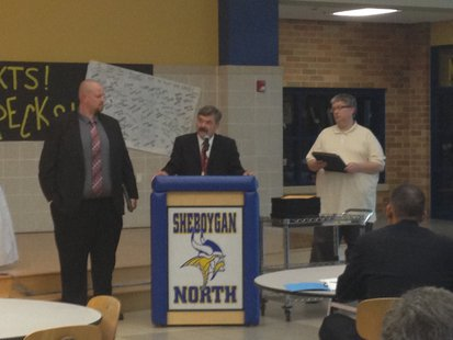 South High School Principal Mike Trimberger (left) receives the Administrator of the Year award from the Sheboygan Area School District for the 2013-2014 school year.  Recognizing him is Superintendent Joe Sheehan (center) and Board President David Gallianetti (right).