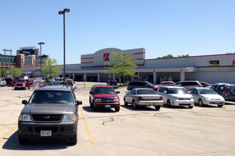 The Kmart store in Ashwaubenon, with Lambeau Field in the background, is seen May 30, 2014. (Photo from: FOX 11)