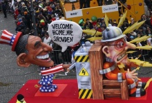 A parade float depicting President Obama throwing the switch of Edward Snowden. Reuters/Ina Fassbender