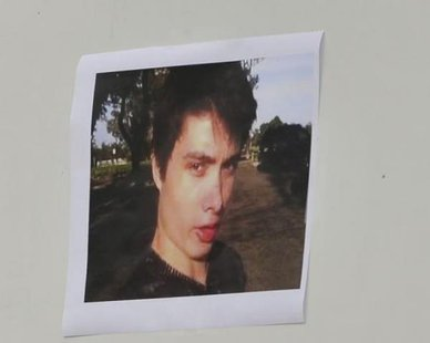 A picture of Elliot Rodger is displayed during a news conference by Santa Barbara County Sheriff Bill Brown (not shown) at Sheriff headquarters in Santa Barbara, California May 24, 2014. CREDIT: REUTERS/PHIL KLEIN
